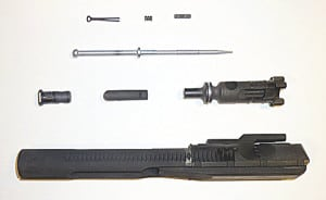 Disassembled AR-15 BCG parts after 45 minutes of submersion in Pristine Cleaning Solution